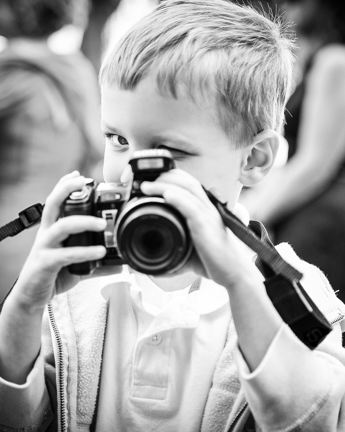 Little boy photographing