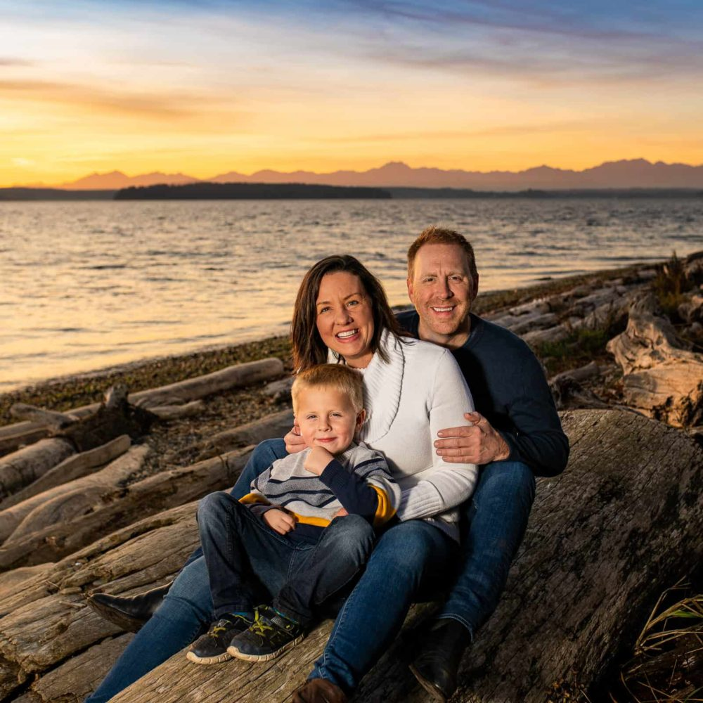 Family enjoying sunset at Lincoln Park in West Seattle